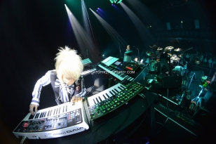 Tokyo, Japan - June 22: Producer/Keyboardist Daisuke Asakura plays for the Legendary Rock Band Fence Of Defense during a concert at Shinagawa Stellar Ball on June 22, 2014 in Tokyo, Japan.(Photo by Hiro Sato)